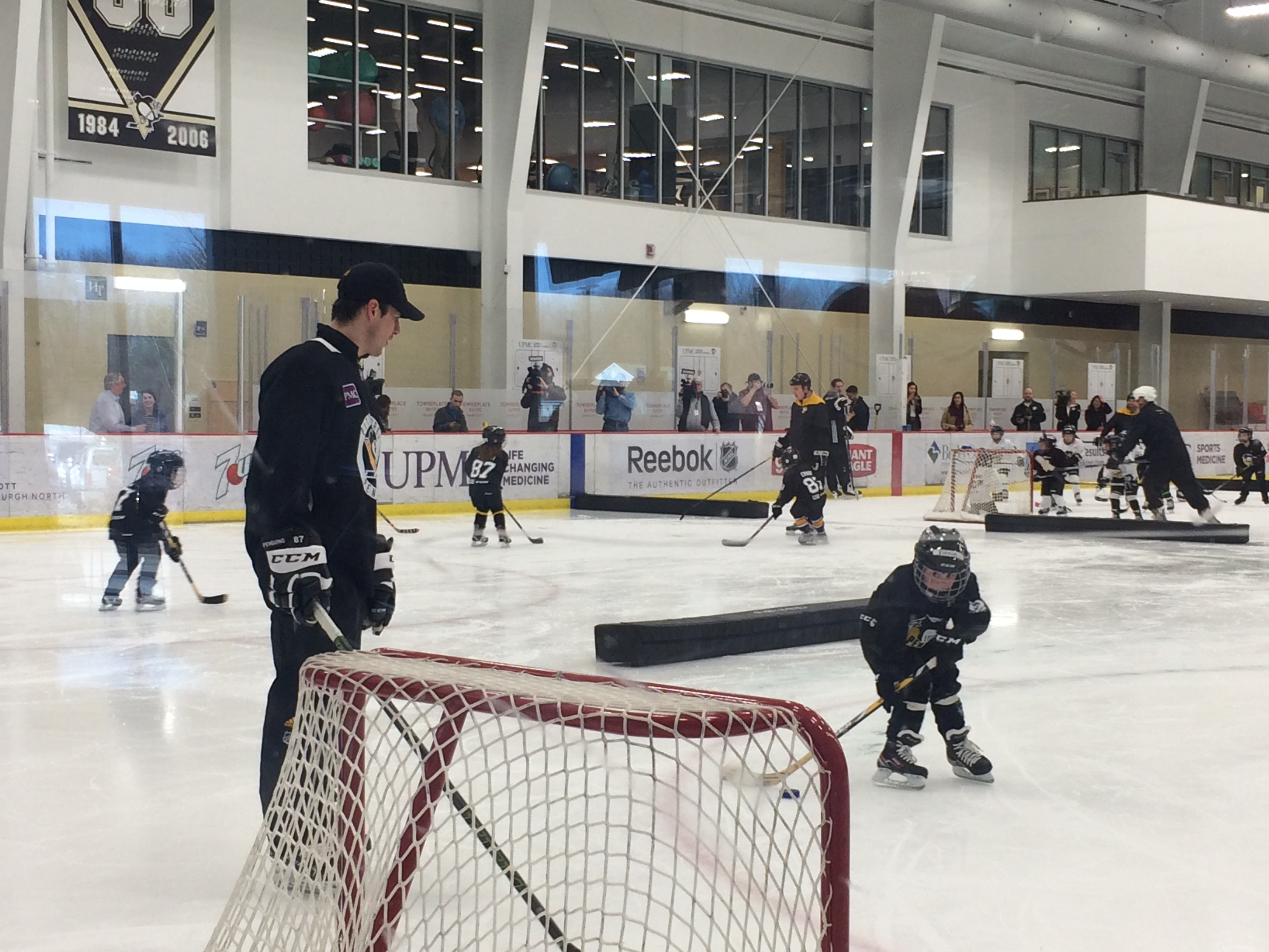 Sidney Crosby watching a small child on the breakaway