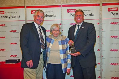 Award recipient Jean Purvis with AARP Director, Bill Johnson Walsh, and AARP President Jim Palmquist.