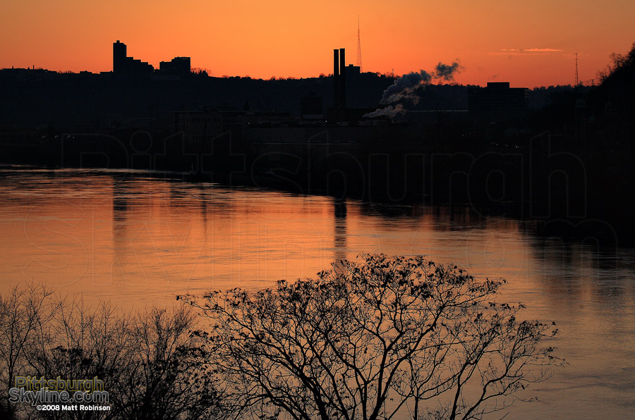 Trimont and Stacks of Heinz reflect in the Allegheny
