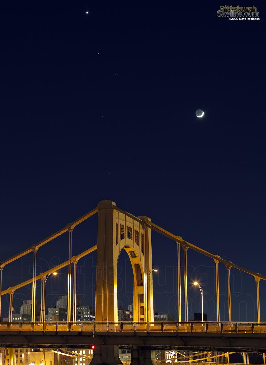 Crescent moon over the Rachel Carson Bridge