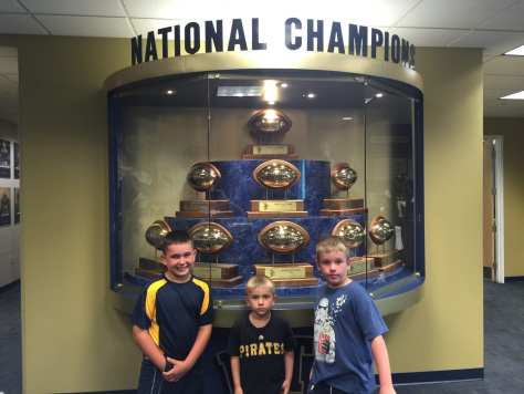 Charlie, Luke and Ryan with the 9 National Championship Trophies
