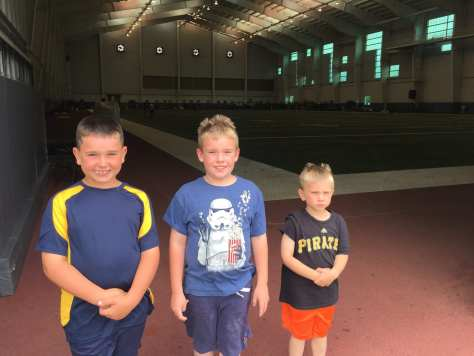 Charlie, Ryan and Luke at the indoor practice facility