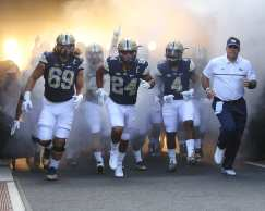 James Conner leads Pitt out of the tunnel before the season opener against Villanova (Photo credit: David Hague)