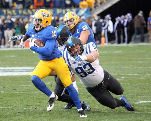Quadree Henderson evades the tackle of A.J. Wolf (Photo by: David Hague)
