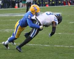 Terrish Webb with the tackle on T.J. Rahming (Photo by: David Hague)