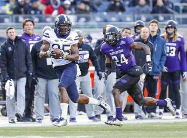 Jester Weah #85 of the Pittsburgh Panthers makes a catch for a touchdown as Montre Hartage #24 of the Northwestern Wildcats is in pursuit. The Northwestern Wildcats defeated the Pittsburgh Panthers 31-24 in the 2016 New Era Pinstripe Bowl at Yankee Stadium on Wednesday, December 28, 2016.