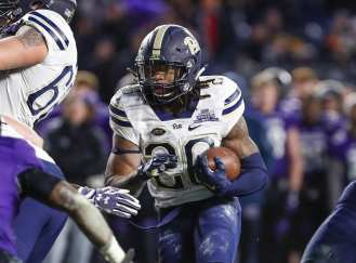 Chawntez Moss #20 of the Pittsburgh Panthers rushes in the second half. The Northwestern Wildcats defeated the Pittsburgh Panthers 31-24 in the 2016 New Era Pinstripe Bowl at Yankee Stadium on Wednesday, December 28, 2016.