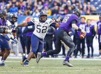Shakir Soto #52 of the Pittsburgh Panthers pressures Clayton Thorson #18 of the Northwestern Wildcats. The Northwestern Wildcats defeated the Pittsburgh Panthers 31-24 in the 2016 New Era Pinstripe Bowl at Yankee Stadium on Wednesday, December 28, 2016.