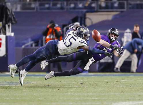 Reggie Mitchell #15 of the Pittsburgh Panthers breaks up a pass to Flynn Nagel #2 of the Northwestern Wildcats. The Northwestern Wildcats defeated the Pittsburgh Panthers 31-24 in the 2016 New Era Pinstripe Bowl at Yankee Stadium on Wednesday, December 28, 2016.