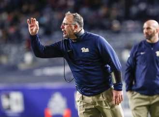 Pittsburgh Panther coach Pat Narduzzi talks to his players. The Northwestern Wildcats defeated the Pittsburgh Panthers 31-24 in the 2016 New Era Pinstripe Bowl at Yankee Stadium on Wednesday, December 28, 2016.