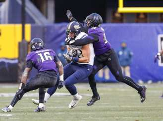 Scott Orndoff #83 of the Pittsburgh Panthers reels in a pass as Nate Hall #32 of the Northwestern Wildcats makes a tackle. The Northwestern Wildcats defeated the Pittsburgh Panthers 31-24 in the 2016 New Era Pinstripe Bowl at Yankee Stadium on Wednesday, December 28, 2016.