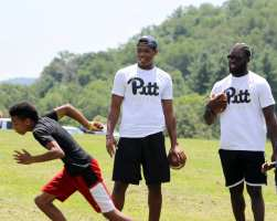 Pitt Freshman run a mini football clinic at the Mel Blount Youth Leadership Initiative (Photo by David Hague)