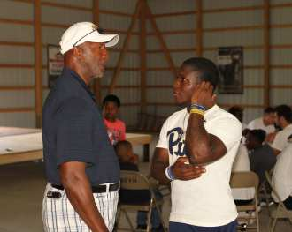 Pitt Freshman talks to Mel Blount at the Mel Blount Youth Leadership Initiative (Photo by David Hague)