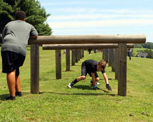 Pitt Freshman help kids on the fitness trail at the Mel Blount Youth Leadership Initiative (Photo by David Hague)