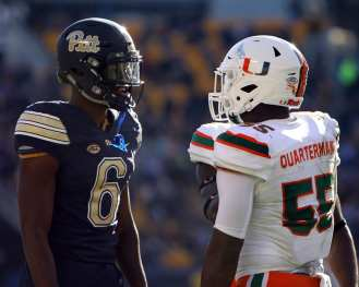 Aaron Mathews (6) and Shaquille Quarterman (55) exchange words after Pitt Touchdown November 24, 2017 -- DAVID HAGUE/PSN