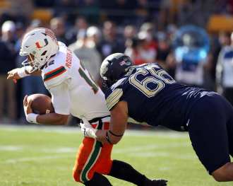 Mike Herndon (66) tried to bring down Malik Rosier (12) November 24, 2017 -- DAVID HAGUE/PSN