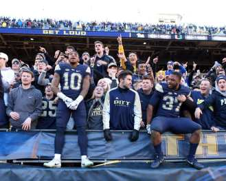 Quadree Henderson (10) and Qadree Ollison (37) celebrates with the Pitt Student Section November 24, 2017 -- DAVID HAGUE/PSN