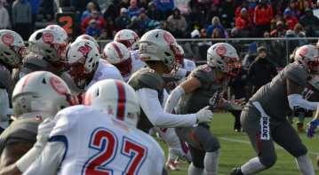 St. John's (gray) and Dematha (white) in the WCAC semifinal. -- ALAN SAUNDERS