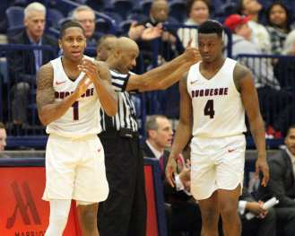 Mike Lewis II (1) celebrates getting a jump ball as the Duquesne Dukes took on Lamar December 19, 2017 -- DAVID HAGUE