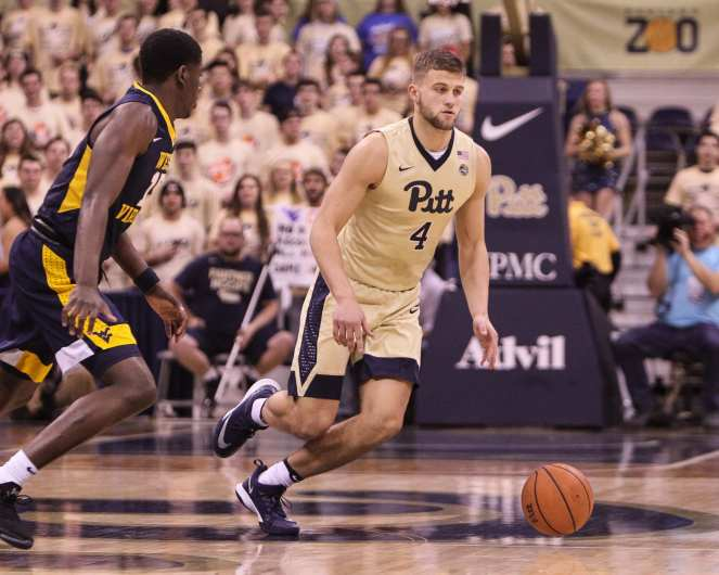 Ryan Luther (4) dribbles up court as the Pitt Panthers take on West Virginia on December 9, 2017 -- DAVID HAGUE