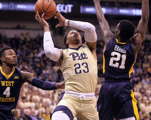 Shemiel Stevenson (23) loses control of the ball on his layup attempt as the Pitt Panthers take on West Virginia on December 9, 2017 -- DAVID HAGUE