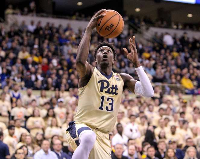Khameron Davis (13) goes in for a layup as the Pitt Panthers take on West Virginia on December 9, 2017 -- DAVID HAGUE