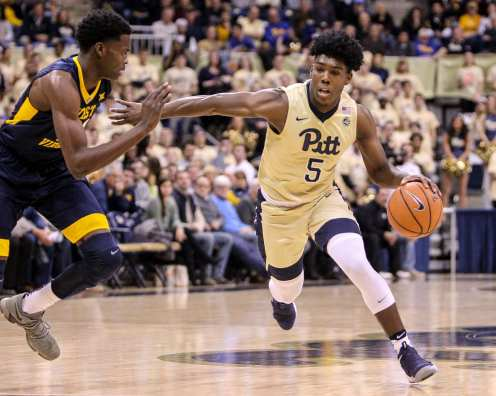 Marcus Carr (5) drives past defender as the Pitt Panthers take on West Virginia on December 9, 2017 -- DAVID HAGUE