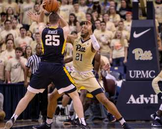 Terrell Brown (21) pressures Maciej Bender (25) of West Virginia as the Pitt Panthers take on West Virginia on December 9, 2017 -- DAVID HAGUE