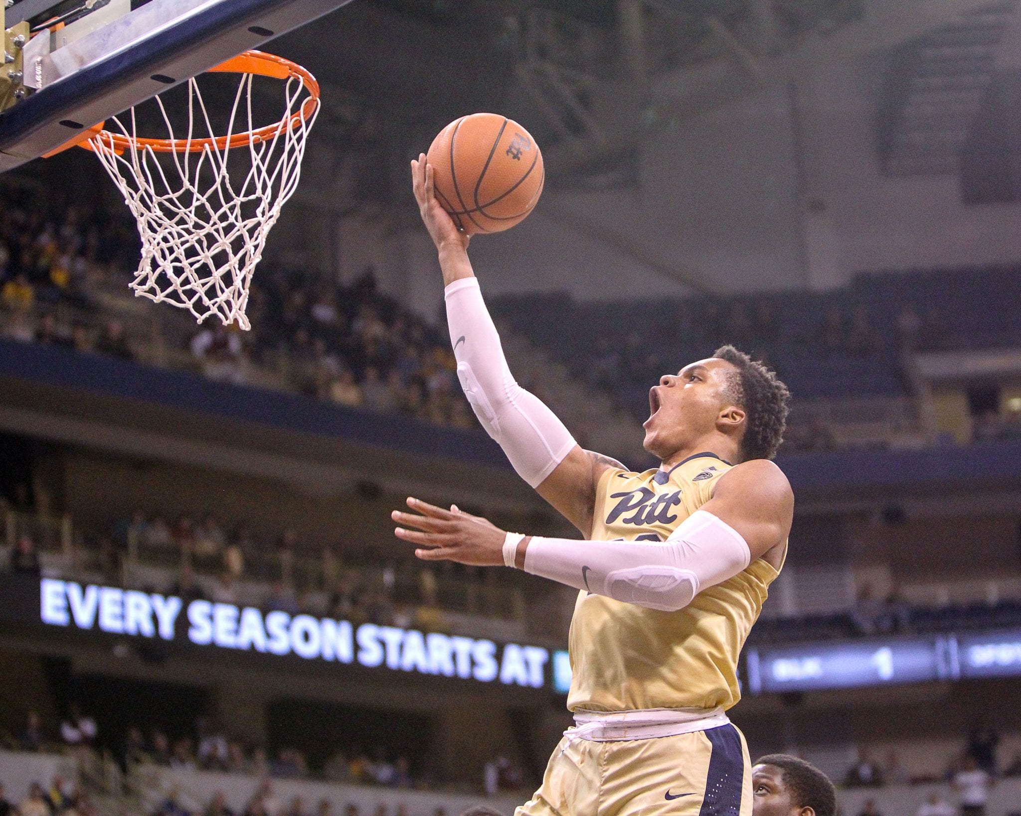 Shamiel Stevenson (23) goes in for a layup as the Pitt Panthers take on West Virginia on December 9, 2017 -- DAVID HAGUE
