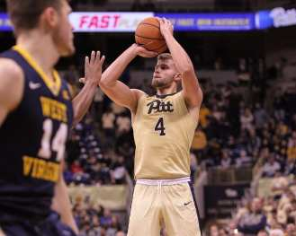 Ryan Luther (4) shoots a 3 pointer as the Pitt Panthers take on West Virginia on December 9, 2017 -- DAVID HAGUE