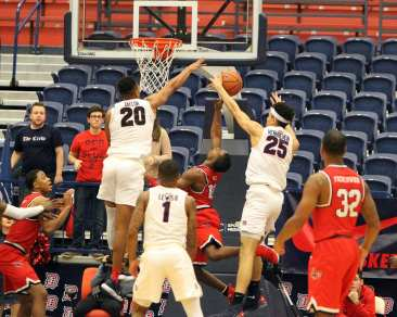 Tydus Verhoeven (25) with the block as the Duquesne Dukes took on Lamar December 19, 2017 -- DAVID HAGUE