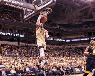 Shemiel Stevenson (23) goes in for the dunk as the Pitt Panthers take on West Virginia on December 9, 2017 -- DAVID HAGUE
