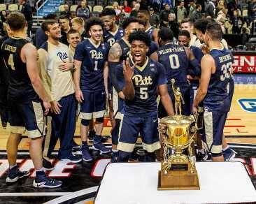 Pitt celebrates winning the City Game at PPG Paints Arena December 1, 2017 -- DAVID HAGUE