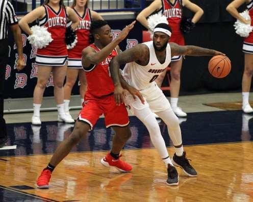 Chas Brown (0) drives to the hoop against Josh Nzeakor (11) as the Duquesne Dukes took on Lamar December 19, 2017 -- DAVID HAGUE
