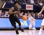 Marcus Carr (5) looks for a lane against Duke on January 10, 2018 -- DAVID HAGUE
