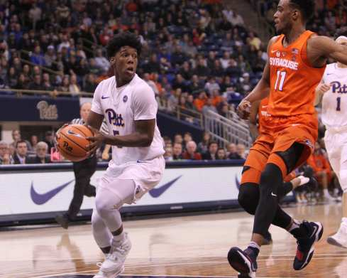 Marcus Carr (5) looks to pass the ball against Syracuse on January 27, 2018 -- DAVID HAGUE