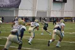 GA Mike Caprara leads a LB drill.