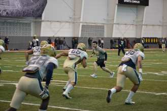 GA Mike Caprara leads a LB drill.