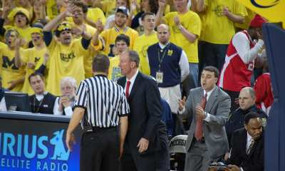 Ohio State University men's basketball coach Thad Matta speaks with a referee during Ohio State's rivalry game vs. Michigan on Jan. 17, 2009 at the Crisler Center. Seated to his right are assistant coaches Archie Miller and Alan Major.
