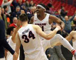 Michael Hughes (21) celebrates with Austin Rotroff (34) December 22, 2018 -- David Hague/PSN