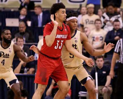 Au'Diese Toney (5) gourds Jordan Nwora (33) January 9, 2019 -- David Hague/PSN