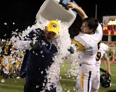 Anderson Cynkar (5) showers his coach with an icy bath November 7, 2020 David Hague/PSN
