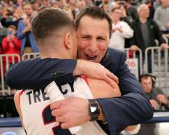 Dante Treacy (3) hugs the coach after winning the NEC March 10, 2020 -- David Hague/PSN