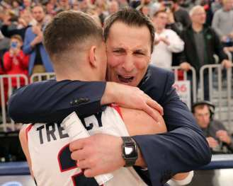 Dante Treacy (3) hugs the coach after winning the NEC March 10, 2020 -- David Hague/PSN