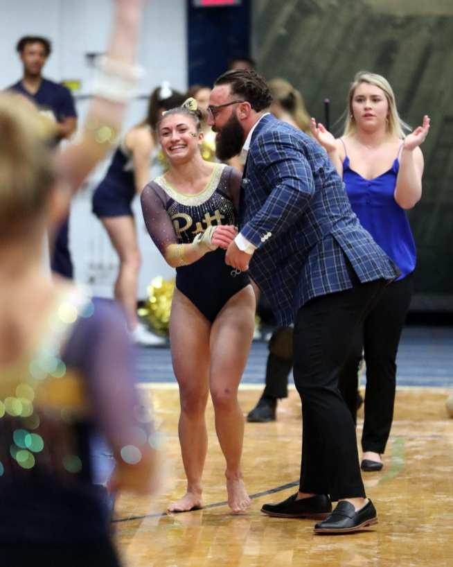 Olivia Miller and Assistant coach Ryan Snider Pitt Gymnastics January 12, 2019 -- David Hague/PSN
