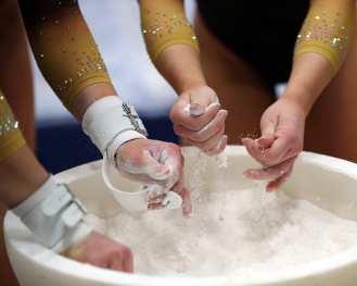 Pitt Gymnastics chalk up their hands January 12, 2019 -- David Hague/PSN
