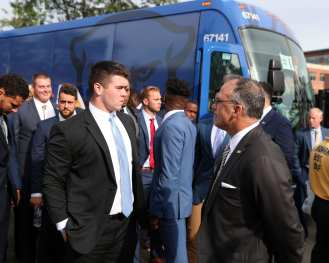 Players exit the bus before opener against Virginia -- August 31, 2019 Photo By David Hague/PSN