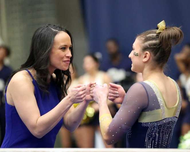 Olivia Miller and Coach Samantha Snider Pitt Gymnastics January 12, 2019 -- David Hague/PSN