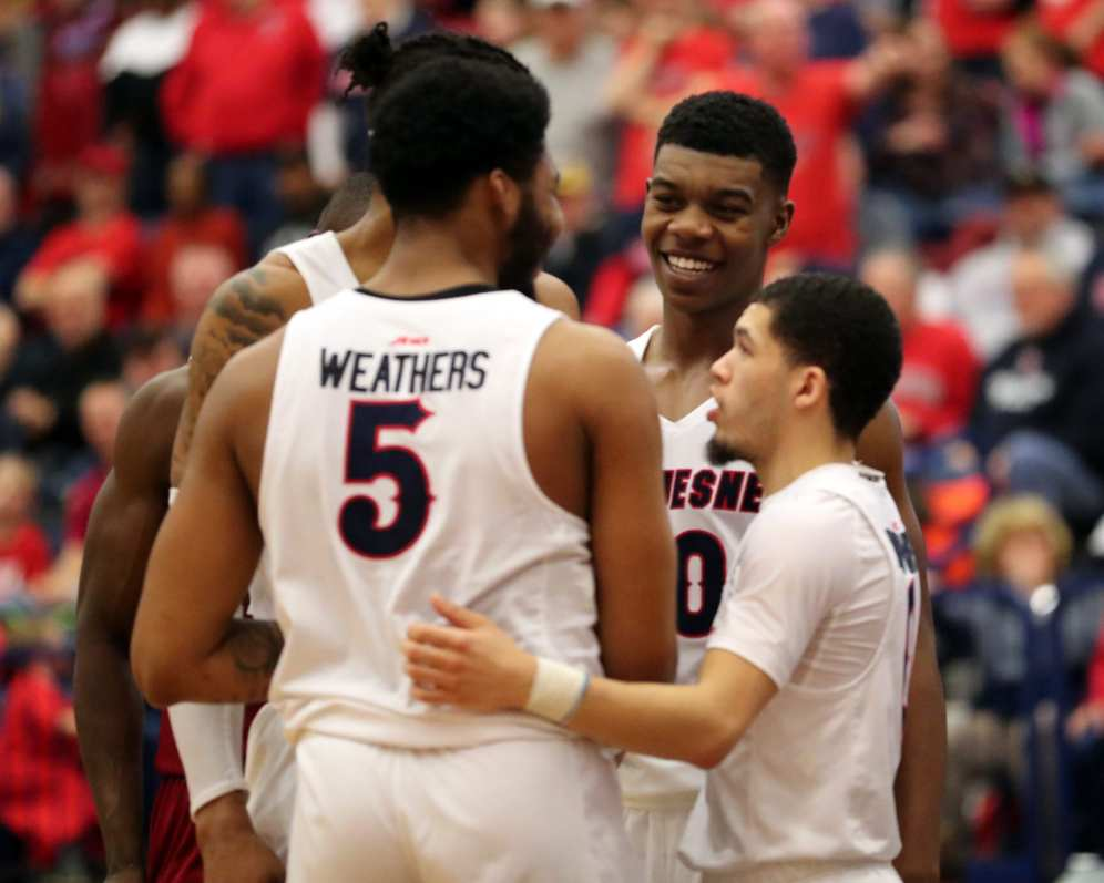 Eric Williams Jr (50) and team celebrate March 2, 2019 -- David Hague/PSN