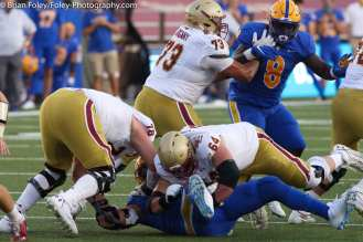 Oct. 10, 2020; Chestnut Hill, Massachusetts, USA; Pittsburgh Panthers defensive lineman Rashad Weaver (17) is hit by Boston College Eagles offensive linemen Tyler Vrabel (78) and Ben Petrula (64) during an ACC matchup between Pittsburgh and Boston College. The Eagles won the game 31-30 in overtime over the Panthers. Credit © Brian Foley for Foley-Photography.